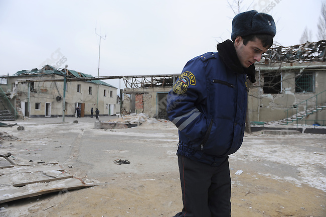 A policeman walked through the yard of a police station in Mahachkala, the Dagestani capital, still seriously damaged from a suicide attack on 6 January 2010 which killed 7 policemen and wounded many others, the most dramatic in a series of attacks on the republic's police forces by terrorists. January 28, 2010