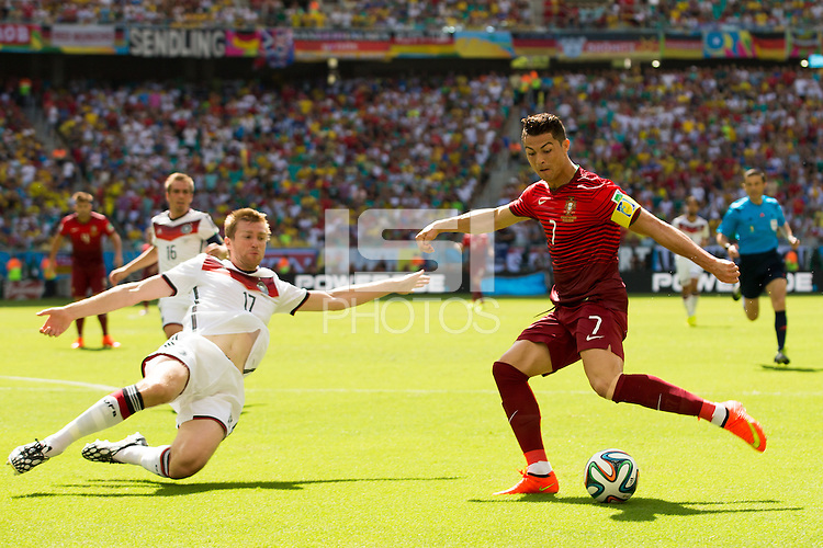 Cristiano Ronaldo of Portugal and Per Mertesacker of Germany