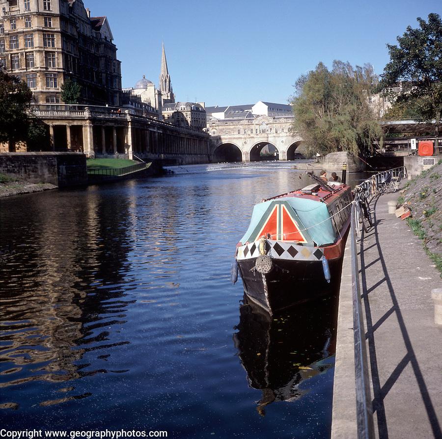 Narrow boat moored on River Avon, Pulteney Bridge, Bath, Somerset, England