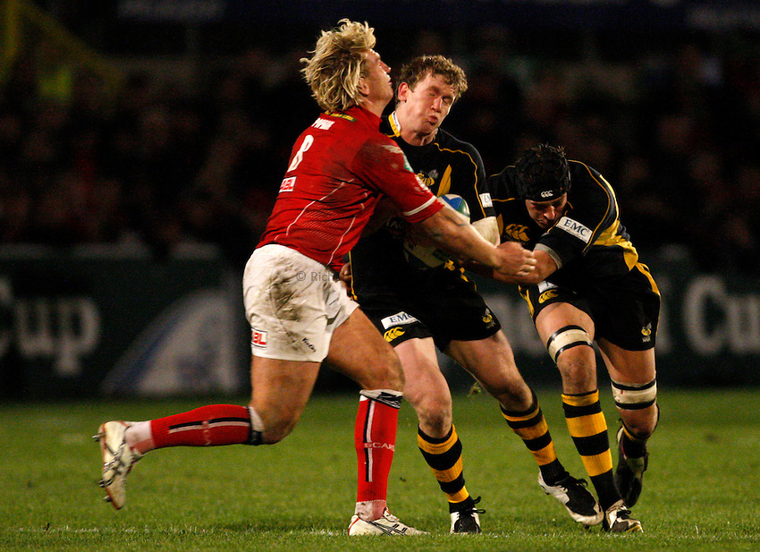 Photo: Richard Lane/Richard Lane Photography..Llanelli Scarlets v London Wasps. Heineken Cup. 17/11/2007. .Wasps' Tom Rees runs at Scarlets' Alix Popham.