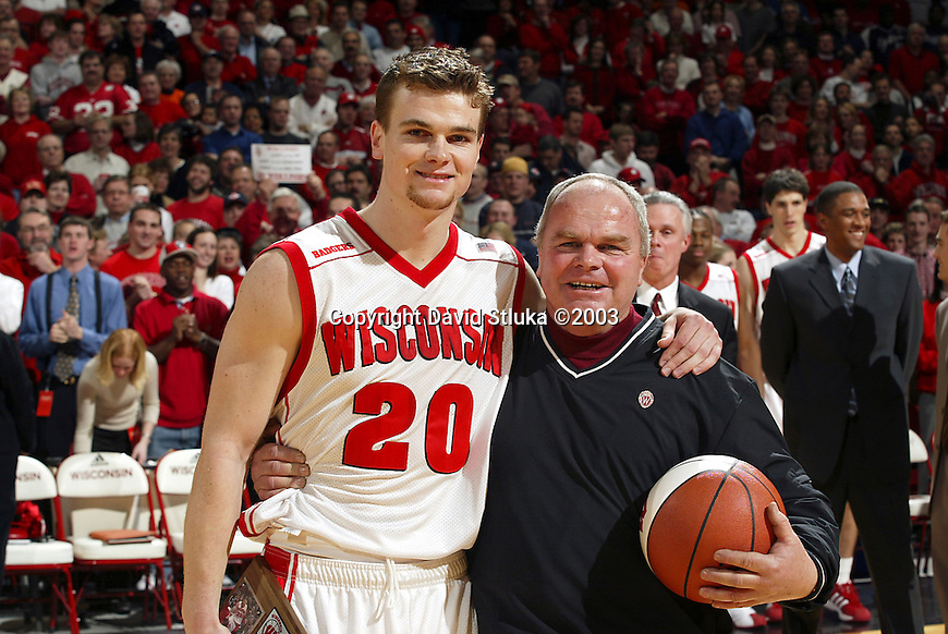 Madison, WI, 3/5/03 - University of Wisconsin guard/forward Kirk Penney (20) with his father before the Illinois game at the Kohl Center. The Badgers 60-59 victory over Illinois marks the first outright conference title for Wisconsin since 1947. ©David Stluka