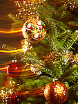 Christmas ornament on Xmas tree with magical light effects