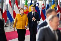 Le Pr&eacute;sident fran&ccedil;ais Emmanuel Macron et Angela Merkel lors de la photo de famille au Sommet europ&eacute;en &agrave; Bruxelles.<br /> Belgique, Bruxelles, 22 mars 2019 <br /> Chancellor of Germany Angela Merkel and President of France Emmanuel Macron pictured during a family photo during the second day of the EU summit meeting at the European Union headquarters in Brussels.<br /> Belgium, Brussels, 22 March 2019.