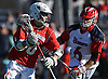 Cory VanGinhoven #40 of Stony Brook, left, gets pressured by Corey Haynes #6 of St. John's University during an NCAA Division I men's lacrosse game at DaSilva Memorial Field in Jamaica, NY on Sunday, Feb. 19, 2017. VanGinhoven tallied three goals and two assists as Stony Brook rallied from an early 4-0 deficit to win 14-5.