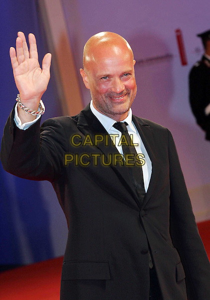 "CHRISTIAN BERKEL.Premiere of ""Zwartboek"" on the third day of the 63rd Venice Film Festival, Venice, Italy..September 1st, 2006.Ref: OME.half length black suit jacket hand palm waving.www.capitalpictures.com.sales@capitalpictures.com.©Omega/Capital Pictures."