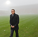 KILMARNOCK MANAGER KENNY SHIELS ON THE PARK AFTER REFEREE BOBBY MADDEN CALLED THE GAME OFF.