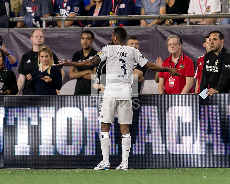 Foxborough, Massachusetts - July 14, 2018: In a Major League Soccer (MLS) match, Los Angeles Galaxy (white) defeated New England Revolution (blue/white), 3-2, at Gillette Stadium.<br /> Red Card: Ashley Cole