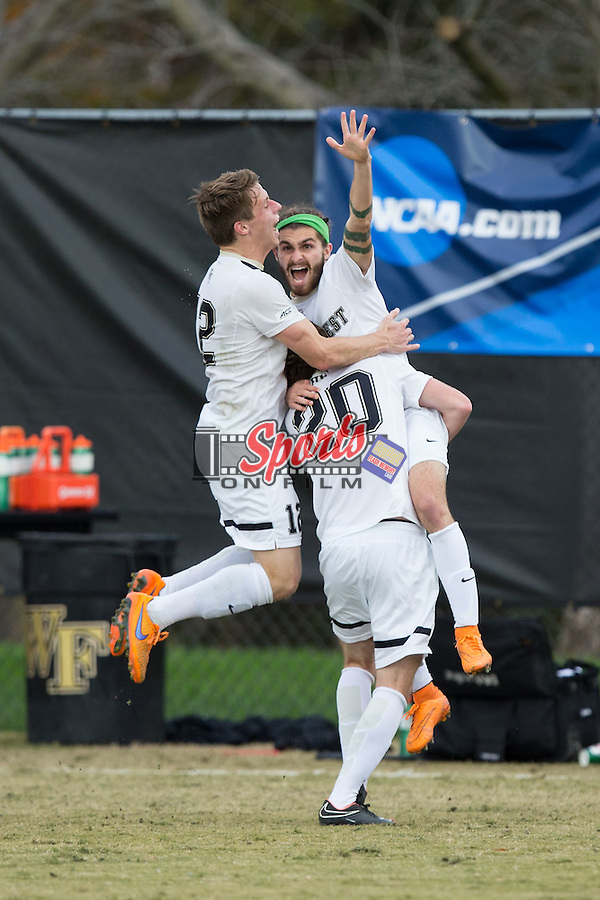 Ricky Greensfelder (25) of the Wake Forest Demon Deacons celebrates with teammates Hunter Bandy (20) and Brad Dunwell (12) after scoring the games only goal against the Indiana Hoosiers in the third round of the 2015 NCAA College Cup at Spry Soccer Stadium on November 22, 2015 in Winston-Salem, North Carolina.  The Demon Deacons defeated the Hoosiers 1-0.  (Brian Westerholt/Sports On Film)