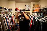 University of California, Merced student Gurbir Dhillon tries on a hat  in his walk-in closet in Merced, Calif., October 29, 2011.