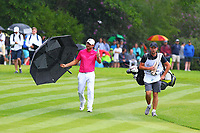 Jordan Smith on a rainy 18th green during the BMW PGA Golf Championship at Wentworth Golf Course, Wentworth Drive, Virginia Water, England on 28 May 2017. Photo by Steve McCarthy/PRiME Media Images.