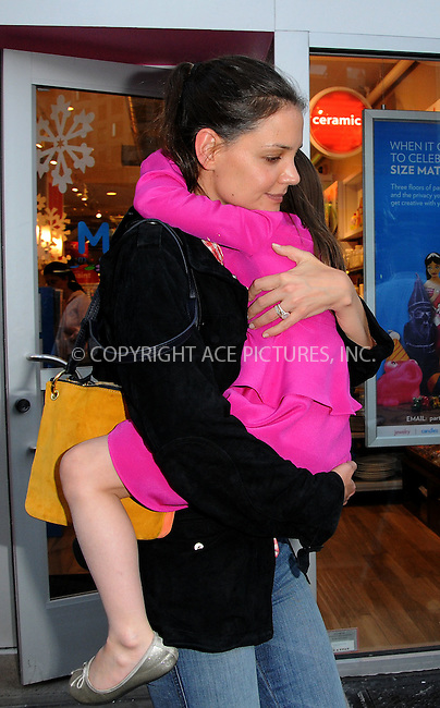 WWW.ACEPIXS.COM . . . . .  ....March 20 2012, New york City....Katie Holmes leaves her apartment with her daughter Suri Cruise on March 20 2012 in New York City....Please byline: CURTIS MEANS - ACE PICTURES.... *** ***..Ace Pictures, Inc:  ..Philip Vaughan (212) 243-8787 or (646) 769 0430..e-mail: info@acepixs.com..web: http://www.acepixs.com