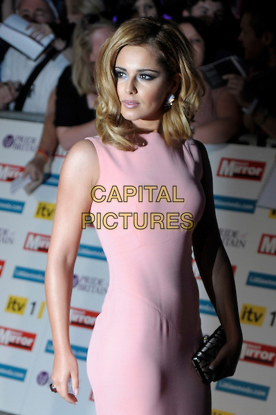 Cheryl Cole (wearing Victoria Beckham).'The Daily Mirror's Pride Of Britain Awards 2011' at Grosvenor House Hotel, London, England..3rd October 2011.half length pink sleeveless dress white silver clutch bag .CAP/PL.©Phil Loftus/Capital Pictures.