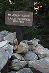 Sign marking the summit of Mt. Megunticook, Camden Hills State Park, Maine, USA.