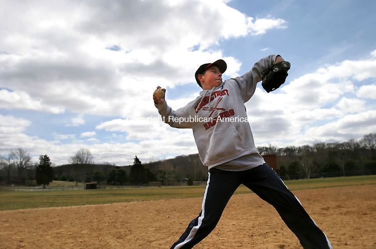 SOUTHBURY, CT 4/8/07- 040807BZ07-  Dave Groman, 14, of Southbury, throws a ball back to his father, Barry Groman, while working on infielding skills at Community Park in Southbury Sunday.   Groman is a member of the Pomperaug High School freshman baseball team. <br /> Jamison C. Bazinet Republican-American