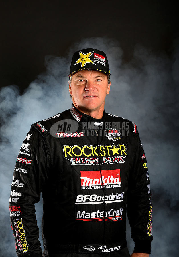 Mar. 21, 2014; Chandler, AZ, USA; LOORRS pro 4 driver Rob MacCachren poses for a portrait prior to round one at Wild Horse Motorsports Park. Mandatory Credit: Mark J. Rebilas-USA TODAY Sports
