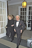 Jack Valenti, President and CEO of the Motion Picture Association of America arrives with his wife, Mary Margaret, at the British Embassy in Washington, DC for the ceremony honoring filmmaker Steven Spielberg on January 29, 2001.<br /> Credit: Ron Sachs / CNP