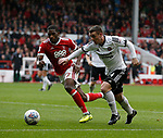 Tendayi Darikwa of Nottingham Forest and John Fleck of Sheffield Utd during the Championship match at the City Ground Stadium, Nottingham. Picture date 30th September 2017. Picture credit should read: Simon Bellis/Sportimage