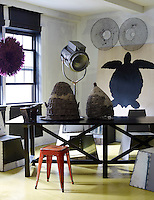 The living area includes a turtle painting by an unknown artist, a pair of Portuguese wire eel traps and a 1950s Hollywood stage light