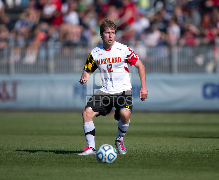 Jereme Raley (12) of Maryland carries the ball forward during the game at the Maryland SoccerPlex in Germantown, MD. Maryland defeated North Carolina, 2-1,  to win the ACC men's soccer tournament.