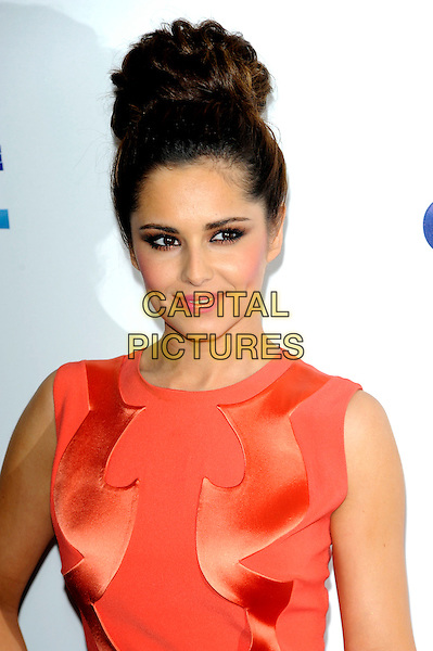 Cheryl Cole.At the Captial FM Summertime Ball held at Wembley Stadium, London, England, UK, 9th June 2012..arrivals portrait headshot sleeveless orange hair up bun .CAP/CJ.©Chris Joseph/Capital Pictures.