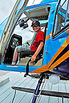 2 August 2009: Passenger Josh Wolfstein gets ready for a scenic tour in a helicopter operated by Blue Skies Charter Service prior to a flight above the Caribbean town of Willemstad, on the island of Curacao, in the Netherlands Antilles. Curaçao is known for tourism, scuba diving, and technologically advanced business districts. Mandatory Photo Credit: Ed Wolfstein Photo
