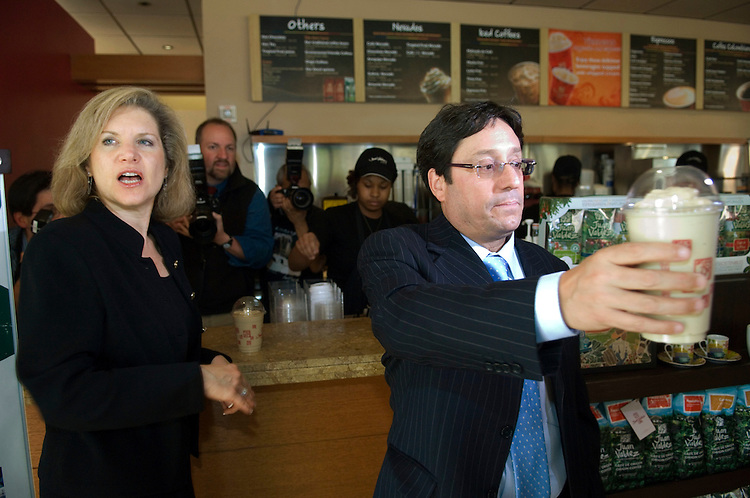 WASHINGTON, DC - April 18: United States Trade Representative Susan C. Schwab and Colombian Vice President Francisco Santos Calderón, passing a cup to Colombian Ambassador to the U.S. Carolina Barco (not pictured), during a photo op at Juan Valdez Coffee Company, on F Street NW, to highlight the Colombian Free Trade Agreement. The shop sells Colombian coffee. Colombia's top officials meanwhile have received no assurances that the pending free-trade agreement will come up for a vote this year, following last week's House vote to suspend action on the pact's implementing legislation. Calderón, who is in Washington to meet with business groups to garner support for the trade deal, said House Speaker Nancy Pelosi, D-Calif., has not made any promises to Colombia that Congress will vote on the trade pact (HR 5724) this year. (Photo by Scott J. Ferrell/Congressional Quarterly)