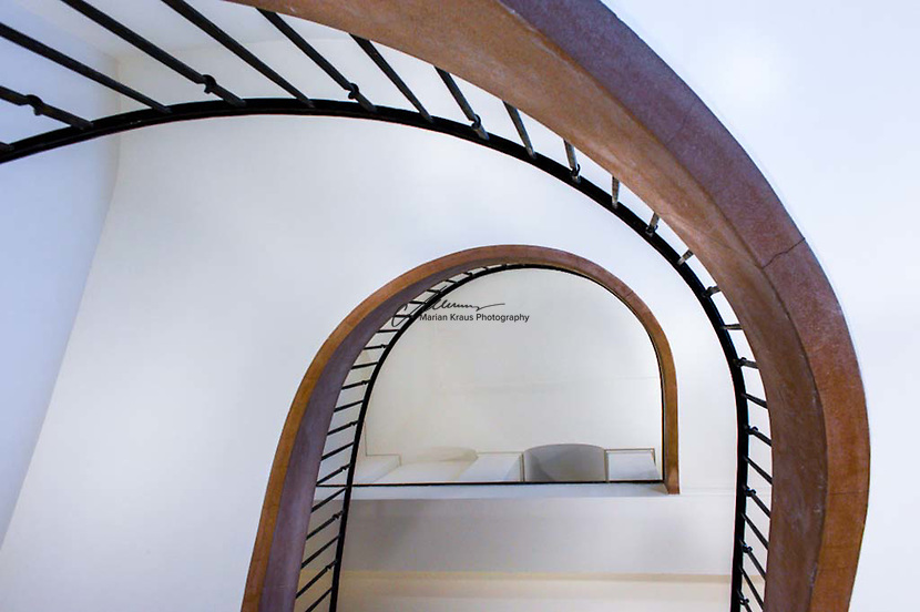 Strikingly beautiful bottom view of a spiral, winding staircase at a university building in Bonn, Germany