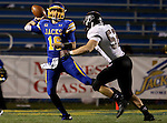 BROOKINGS, SD - OCTOBER 11:  Zach Lujan #16 from South Dakota State passes the ball while being pressured by Andrew Beisel #52 from Missouri State in the first half of their game Saturday evening at Coughlin Alumni Stadium in Brookings. (Photo/Dave Eggen/Inertia)