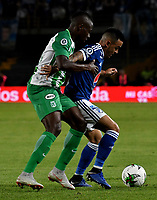 BOGOTÁ - COLOMBIA, 11-01-2019: Santiago Montoya (Der.) jugador de Millonarios disputa el balón con Helibelton Palacios (Izq.) jugador de Atlético Nacional, durante partido entre Millonarios y Atlético Nacional, por el Torneo Fox Sports 2019, jugado en el estadio Nemesio Camacho El Campin de la ciudad de Bogotá. / Santiago Montoya (R) player of Millonarios vies for the ball with Helibelton Palacios (L) during a match between Millonarios y Atletico Nacional, for the Fox Sports Tournament 2019, played at the Nemesio Camacho El Campin stadium in the city of Bogota. Photo: VizzorImage / Luis Ramírez / Staff.
