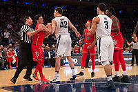 NEW YORK, NY - Thursday March 9, 2017: Federico Mussini (#4) of St. John's and Dylan Painter (#42) of Villanova fight for a ball as the two schools square off in the Quarterfinals of the Big East Tournament at Madison Square Garden.