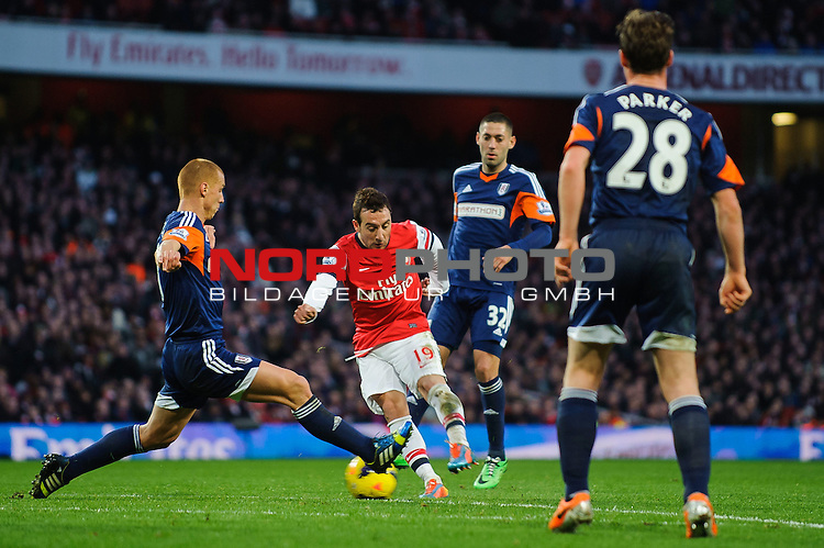 Arsenal Midfielder Santi Cazorla (ESP) turns and shoots scoring his sides 2nd goal during the match -  - 18/01/14 - SPORT - FOOTBALL - Emirates Stadium - Arsenal v Fulham - Barclays Premier League.<br /> Foto nph / Meredith<br /> <br /> ***** OUT OF UK *****