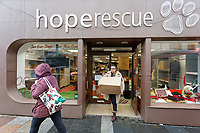 Pictured: A volunteer moves boxes of stock out of Hoperscue charity shop in Taff Street, Pontypridd. Wednesday 04 March 2020<br /> Re: Revisiting the flood affected areas in Pontypridd, Wales, UK.