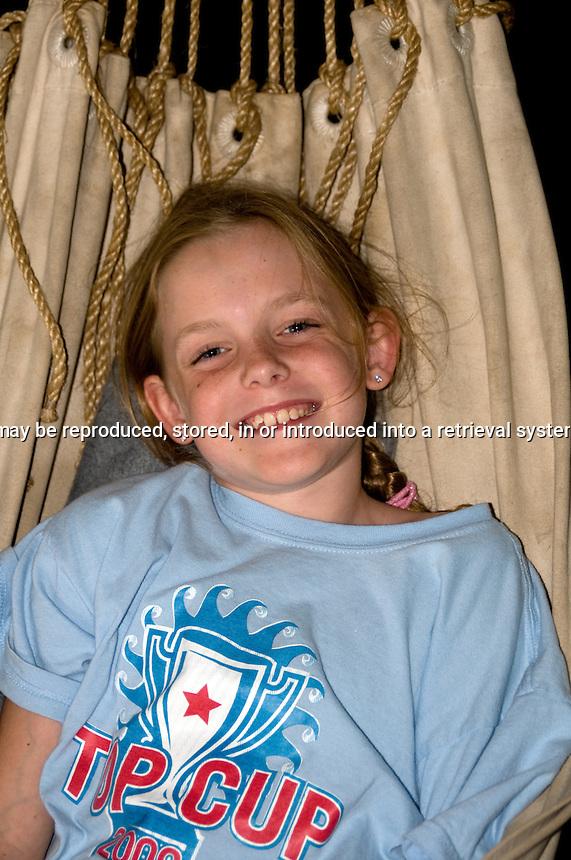 young girl having fun in a hammock