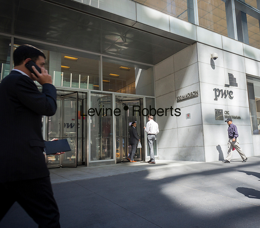 The New York offices of PricewaterhouseCoopers (PWC), the multinational accounting firm, on Madison Avenue on Wednesday, September 17, 2014. A federal judge recently ordered the accounting firm to account for it's alleged bad accounting advice causing the bankruptcy of the brokerage MF Global Holdings in October 2011. PWC faces a $1 billion lawsuit.   (© Richard B. Levine)