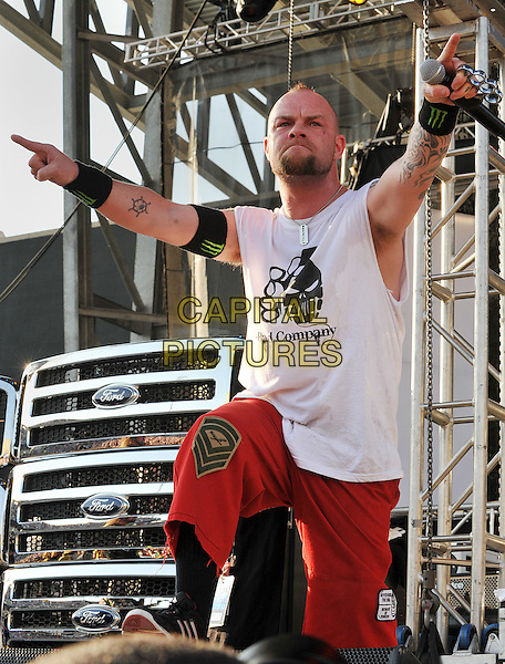 """Lead vocalist IVAN MOODY of the band FIVE FINGER DEATH PUNCH performs at Day 1 of the  'Rock On The Range Festival"""" held at Crew Stadium, Columbus, OH., USA..May 19th, 2012       .on stage in concert live gig performance performing half length white sleeveless top tattoos hand finger pointing goatee facial hair                      .CAP/ADM/JN.©Jason L Nelson/AdMedia/Capital Pictures."""