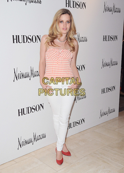 GEORGIA MAY JAGGER.launch of 'Hudson by Georgia May Jagger' designer jeans at Neiman Marcus in Beverly Hills, California, USA  17th March 2011.full length white jeans denim pink orange peach gingham check top shoes red strapless     .CAP/RKE/DVS.©DVS/RockinExposures/Capital Pictures.