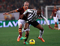 Calcio, quarti di finale di Coppa Italia: Roma vs Juventus. Roma, stadio Olimpico, 21 gennaio 2014.<br /> AS Roma midfielder Radja Nainggolan, of Belgium, and Juventus defender Angelo Ogbonna, right, fight for the ball the Italian Cup round of eight final football match between AS Roma and Juventus, at Rome's Olympic stadium, 21 January 2014.<br /> UPDATE IMAGES PRESS/Isabella Bonotto