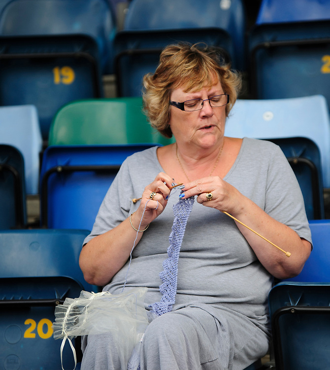 A Lincoln City fan does her knitting during the match<br /> <br /> Photographer Andrew Vaughan/CameraSport<br /> <br /> The EFL Sky Bet League One - Wycombe Wanderers v Lincoln City - Saturday 7th September 2019 - Adams Park - Wycombe<br /> <br /> World Copyright © 2019 CameraSport. All rights reserved. 43 Linden Ave. Countesthorpe. Leicester. England. LE8 5PG - Tel: +44 (0) 116 277 4147 - admin@camerasport.com - www.camerasport.com