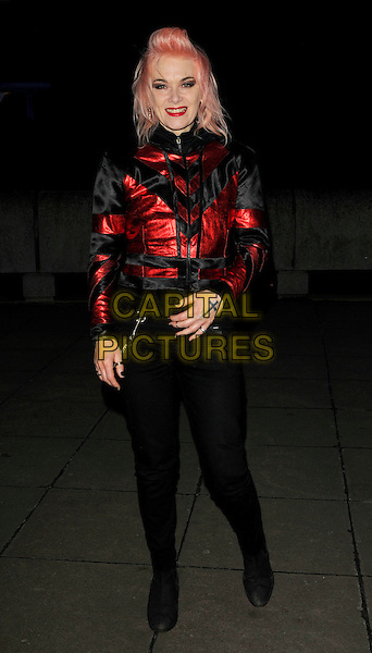 """PAM HOGG.The """"Andy Warhol"""" Other Voices, Other Rooms"""" private view, hayward gallery, South bank, London, England..October 6th, 2008.full length black trousers jacket red cross crucifix tattoo.CAP/CAN.©Can Nguyen/Capital Pictures."""