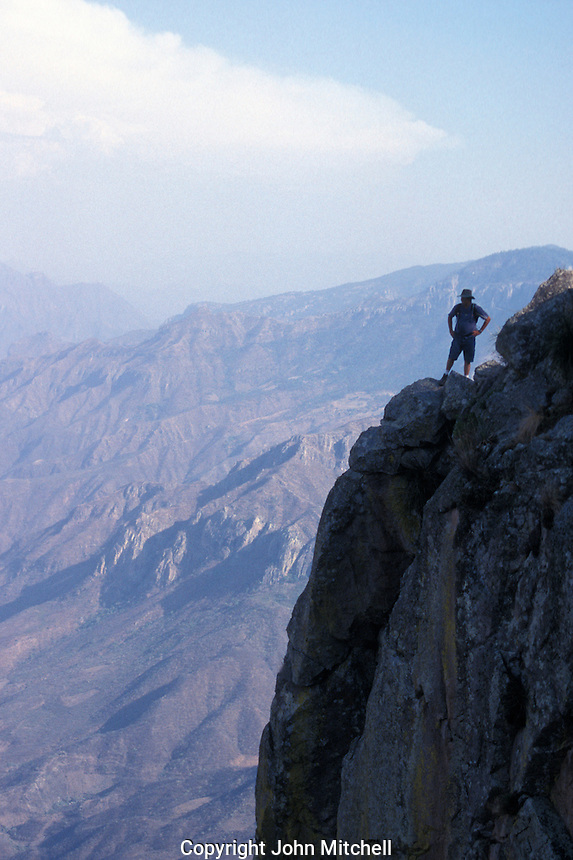 Hiker standing on the rim of the Copper Canyon or Barranca del Cobre, Chihuahua, Mexico