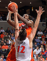 Clemson guard Rod Hall (12) shoots over Virginia guard Joe Harris (12) during the game against Clemson Thursday in Charlottesville, VA.