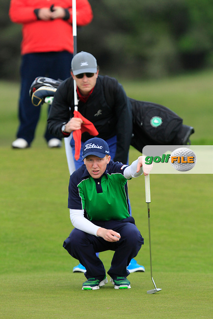 Gavin Moynihan on the 16th green during Round 3 of the Irish Amateur Open Championship at Royal Dublin on Saturday 9th May 2015.<br /> Picture:  Thos Caffrey / www.golffile.ie