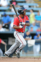 Rome Braves third baseman Carlos Franco #11 swings at a pitch during a game against the Asheville Tourists at McCormick Field on July 25, 2013 in Asheville, North Carolina. The Tourists won the game 9-6. (Tony Farlow/Four Seam Images)