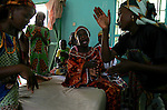 Patients at the Kwali Rehabilitaion Center in Kano, Nigeria sing as a they practice a song of welcome before a visit by singer Natalie Imbruglia in her role as an ambassador for the Virgin Unite charity organization and the United Nations Population Fund. The women at the center are recovering from surgery to eliminate a condition known as fistula and waiting to be returned and re-integrated to their home communities. The center also tries to teach them basic skills such as literacy and knitting and sewing. Imbruglia and UNFPA, the United Nations Population Fund, are working to bring awareness to obstetric fistula, a devastating injury of childbirth that affects more than two million women in developing countries, particularly Nigeria where half of known cases are found. The condition, caused by damage to the walls of the vagina during protracted labor, usually leads to the death of the child and leaves affected women incontinent and often disowned by their husbands and communities.