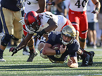 Annapolis, MD - September 23, 2017: Navy Midshipmen quarterback Zach Abey (9) gets tackled by Cincinnati Bearcats safety Chris Murphy (30) during the game between Cincinnati and Navy at  Navy-Marine Corps Memorial Stadium in Annapolis, MD.   (Photo by Elliott Brown/Media Images International)