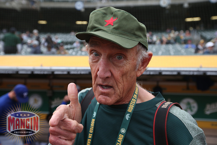 OAKLAND, CA - APRIL 5:  Oakland Athletics team photographer Michael Zagaris models a Cuban army cap before the game against the Texas Rangers at the Oakland Coliseum on Thursday, April 5, 2018 in Oakland, California. (Photo by Brad Mangin)