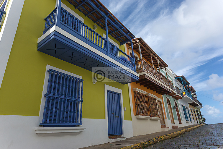 COBBLESTONE STREET COLORFUL PAINTED BUILDINGS CALLE SAN JUSTO OLD SAN JUAN PUERTO RICO