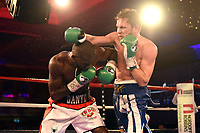 Stephen Danyo (white/red shorts) defeats Lloyd Ellett to win the WBO European Welterweight Title during a Charity Dinner Boxing Show at the Hilton Hotel on 13th November 2017