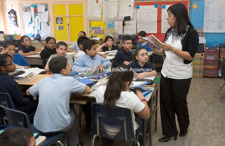 WATERBURY, CT. 25 March 2011-032511SV02--Maria Jimenez reads a passage to her 5th grade class at Washington Elementary School in Waterbury Friday. The school hosted a CommPACT meeting, which is a school reform model for the school and West Side Middle School. The model helps students close the achievement gap.<br /> Steven Valenti Republican-American