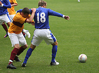 Phil Neville being challenged by Adam Cummins in the Motherwell v Everton friendly match at Fir Park, Motherwell on 21.7.12 for Steven Hammell's Testimonial.